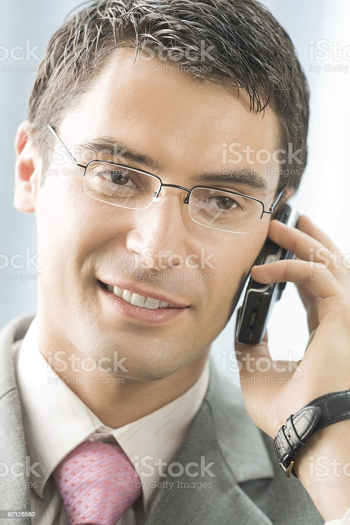 Businessman with cellphone at office royalty-free stock photo