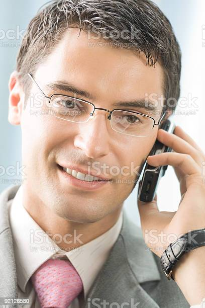 Businessman With Cellphone At Office Stock Photo - Download Image Now