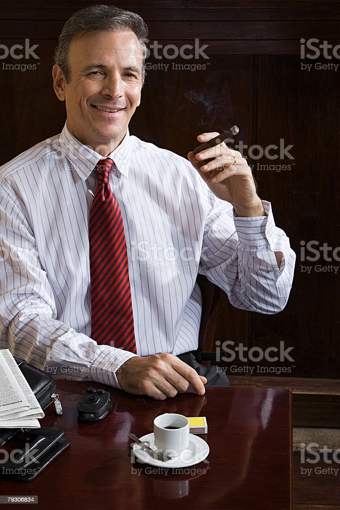 Businessman with cigar royalty-free stock photo