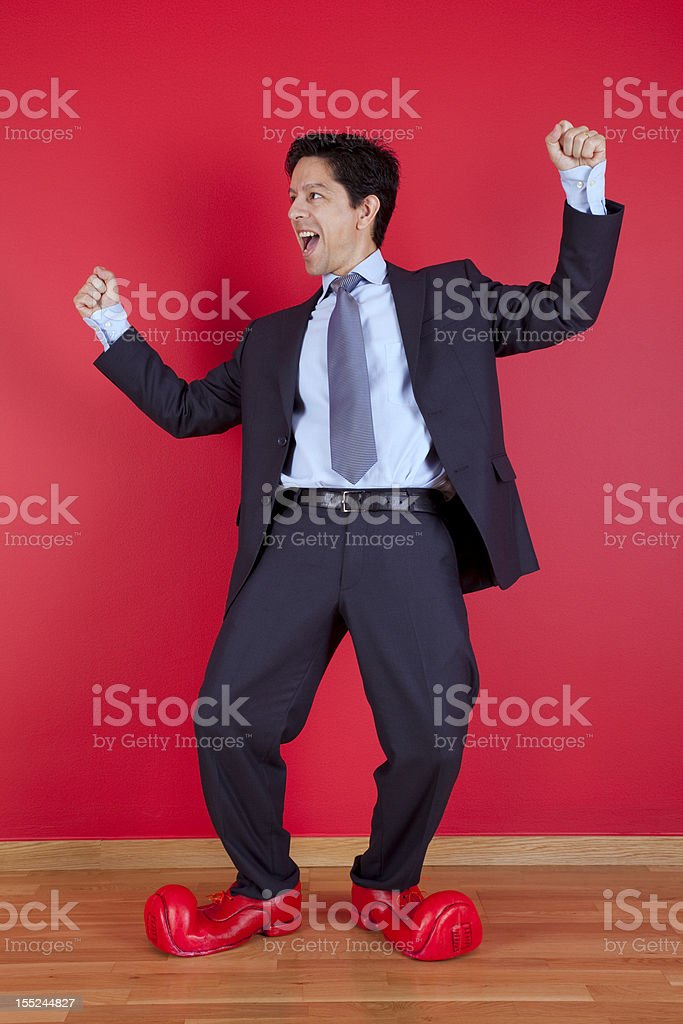 Businessman with clown shoes royalty-free stock photo