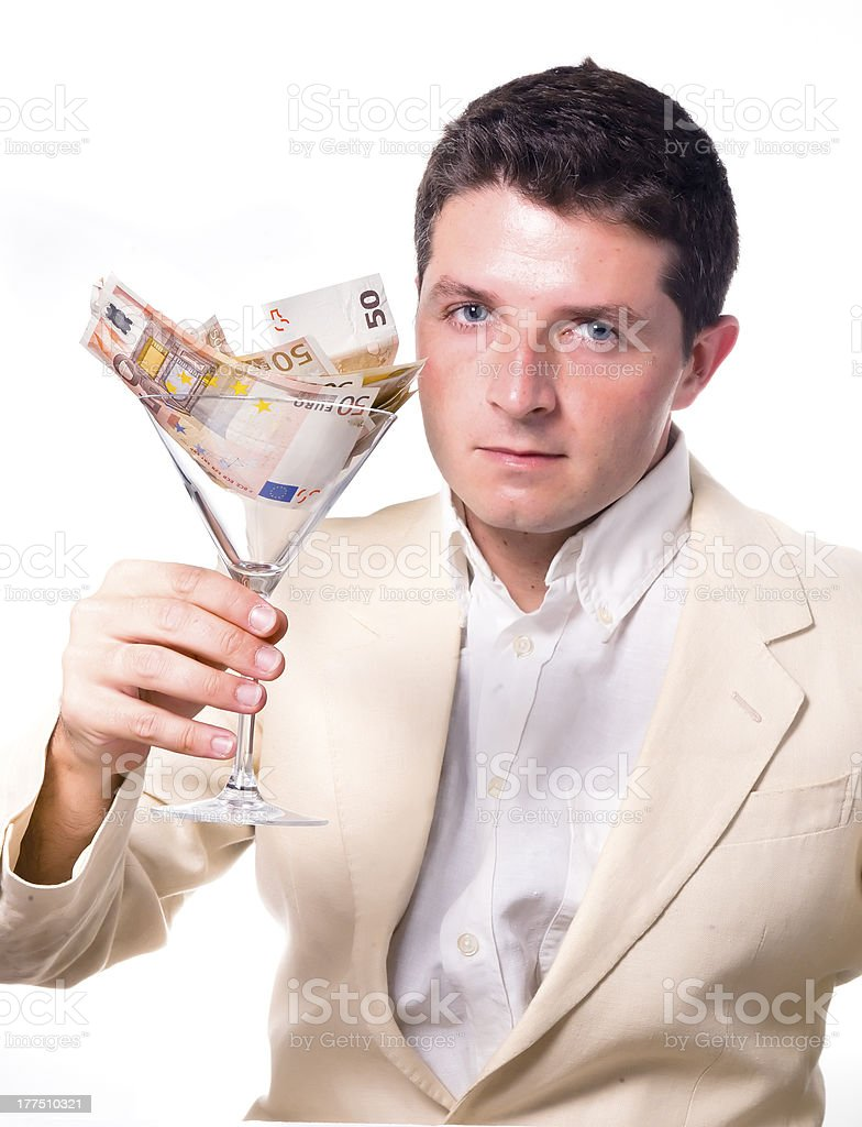 Businessman with Cocktail Glass full of Banknotes royalty-free stock photo