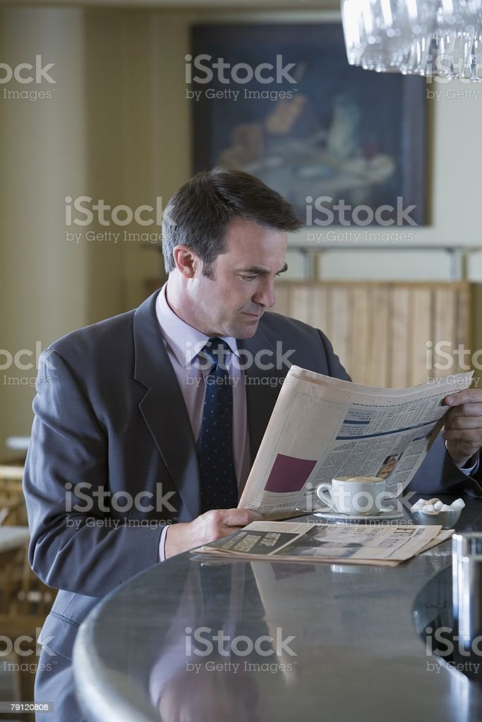 Businessman with coffee and newspaper royalty-free stock photo