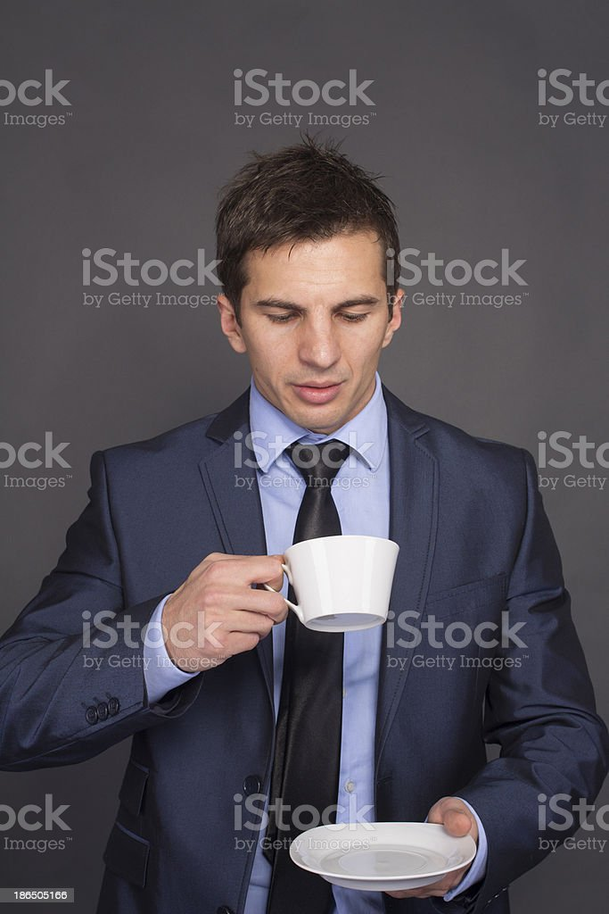 Businessman with Coffee Cup on gray royalty-free stock photo