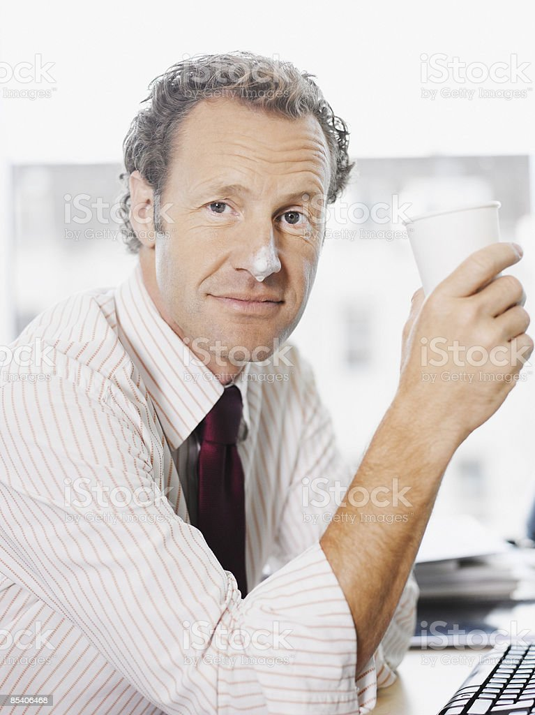 Businessman with coffee foam on nose royalty-free stock photo