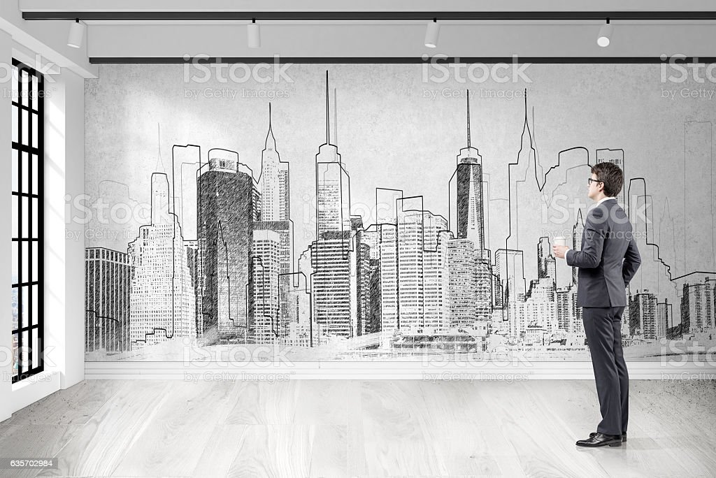 Businessman with coffee looking at city sketch royalty-free stock photo