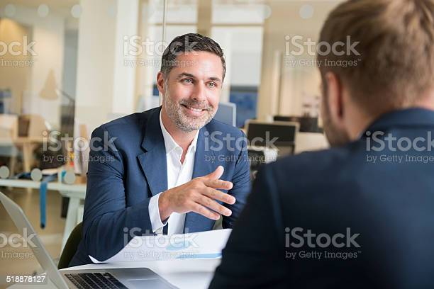 Businessman With Colleague In Meeting Stock Photo - Download Image Now
