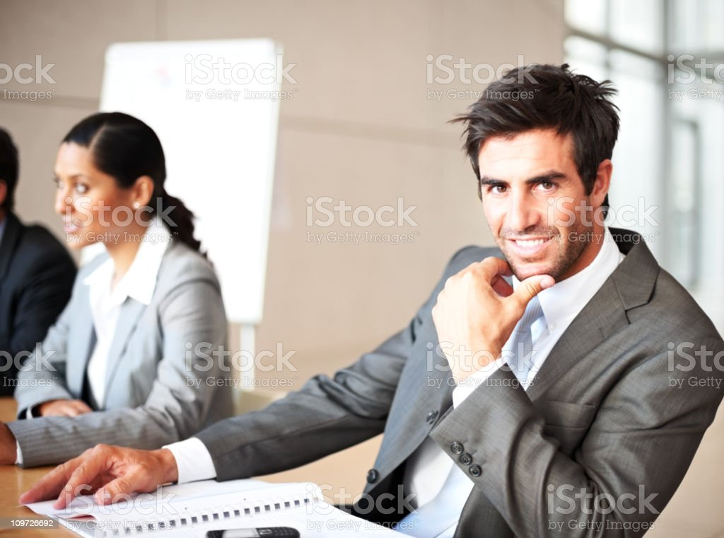 Businessman with colleagues beside him royalty-free stock photo