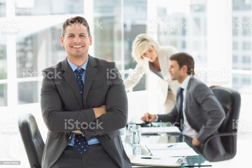 Businessman with colleagues discussing in office stock photo