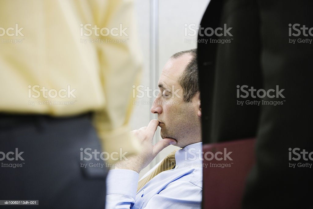 Businessman with colleagues royalty-free stock photo