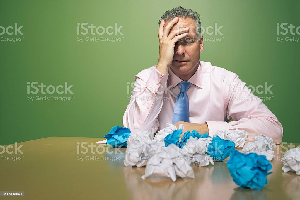 Businessman with crumpled papers stock photo