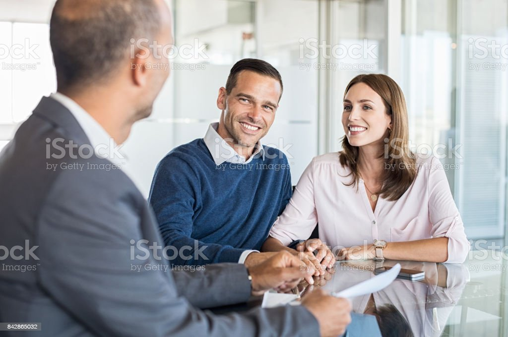 Businessman with customers stock photo