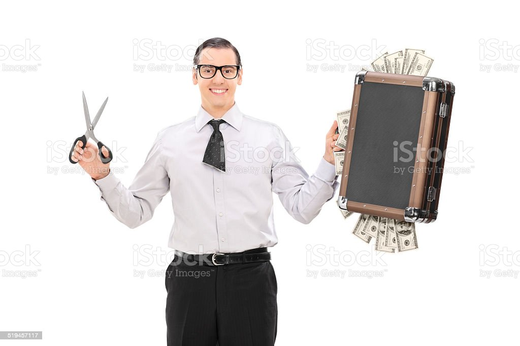 Businessman with cut tie holding bag full of money stock photo