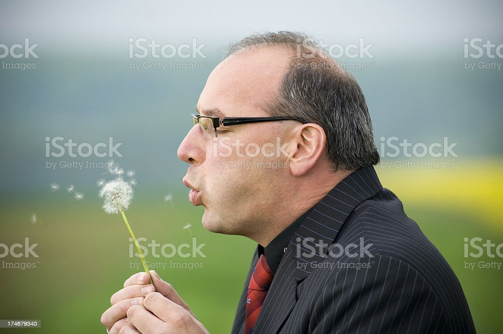 Businessman with dandelion stock photo