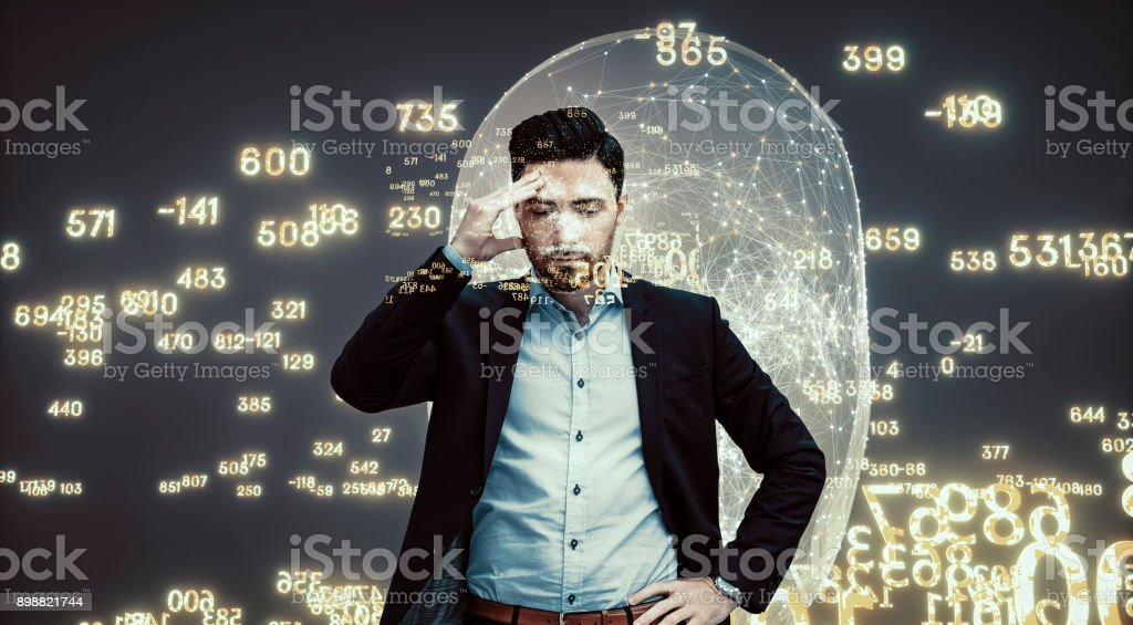 Businessman with data flow headache stock photo