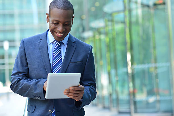 Businessman with digital tablet stock photo