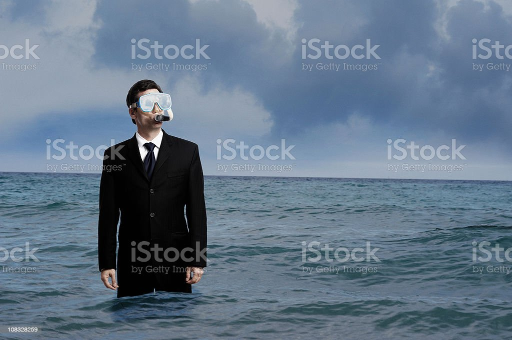 Businessman with Diving Mask and Snorkel in Ocean stock photo
