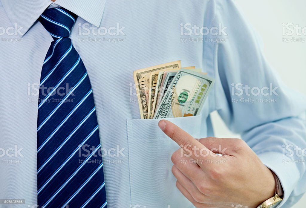 Businessman with dollars in shirt pocket stock photo