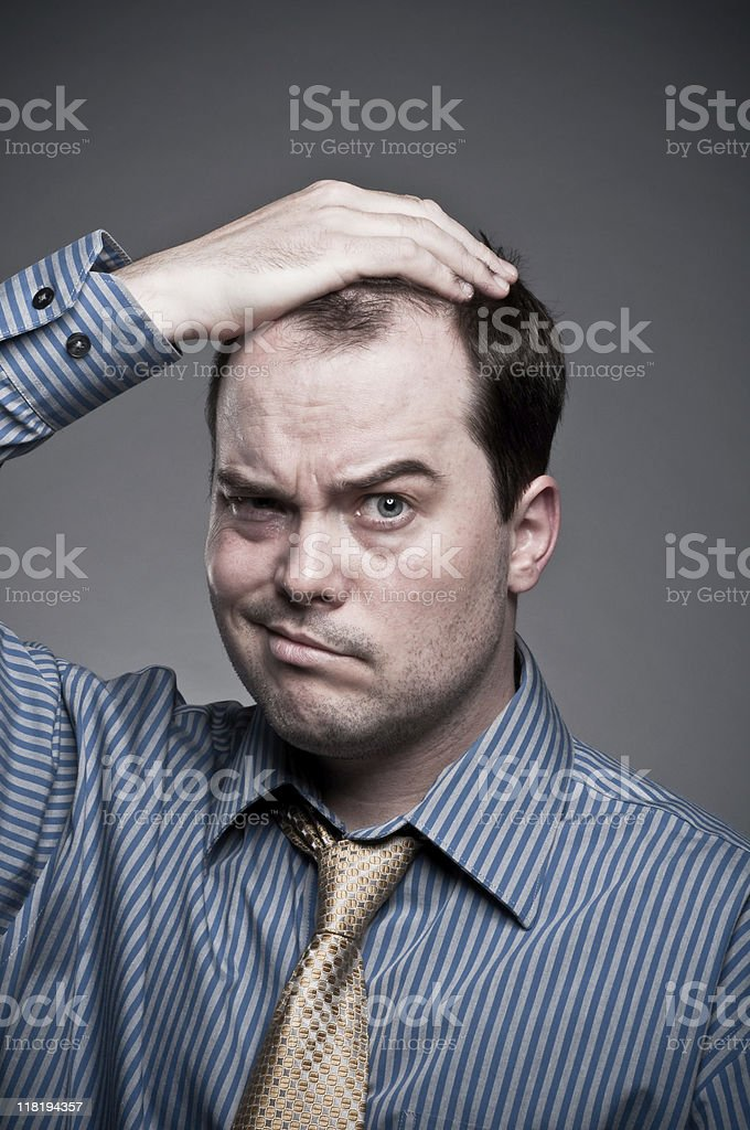 Businessman with doubts stock photo