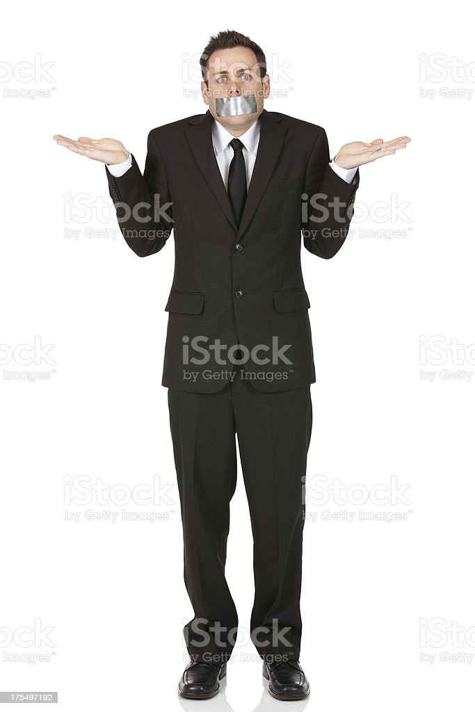 Businessman with duct tape over mouth royalty-free stock photo