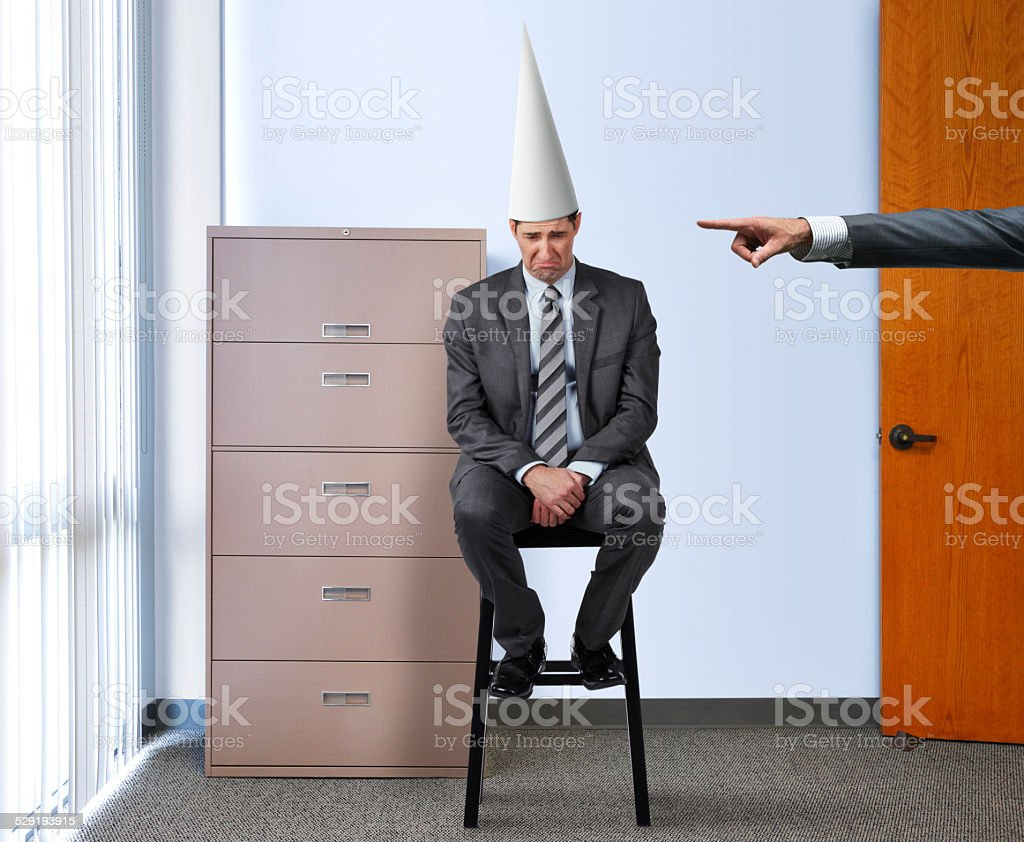 Businessman with Dunce Cap stock photo