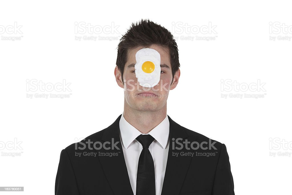 Businessman with egg on face stock photo