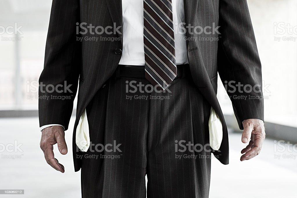 Businessman with empty pockets stock photo