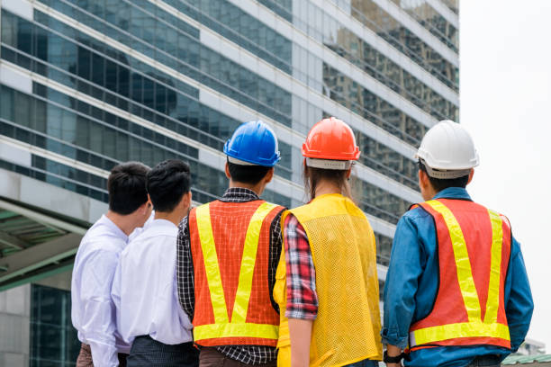 Businessman with engineer group partnership cooperation for construction Businessman with engineer group partnership cooperation for construction project labor union stock pictures, royalty-free photos & images