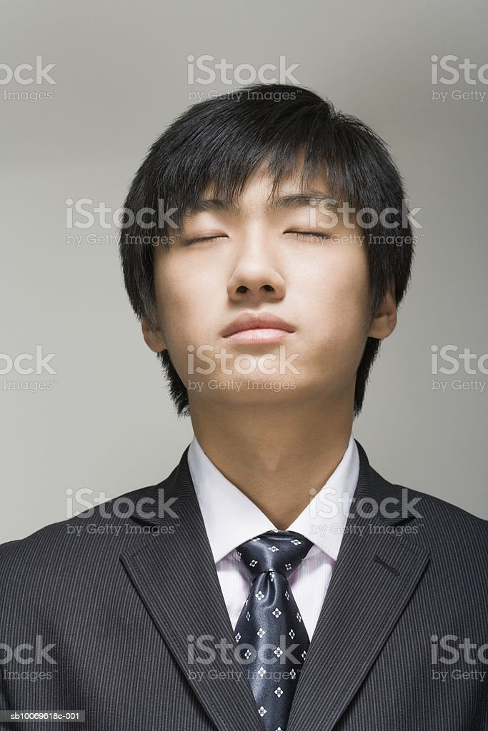 Businessman with eyes closed, close-up photo libre de droits
