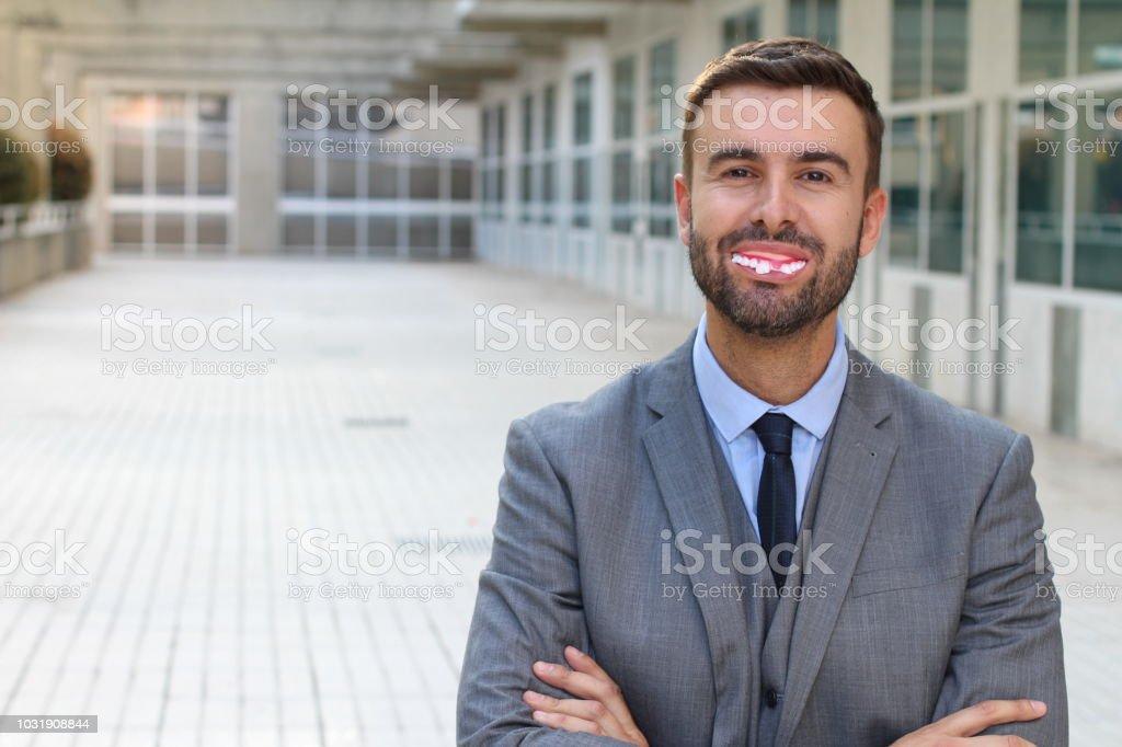 Businessman with fake dentures smiling royalty-free stock photo