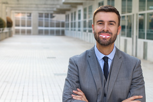 Businessman With Fake Dentures Smiling Stock Photo - Download Image Now