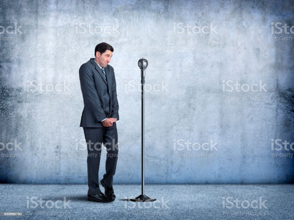 Businessman With Fear Of Public Speaking stock photo
