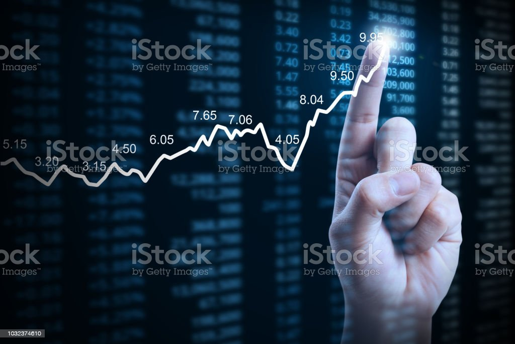 Businessman With Financial Chart Symbols Coming From Hand Stock