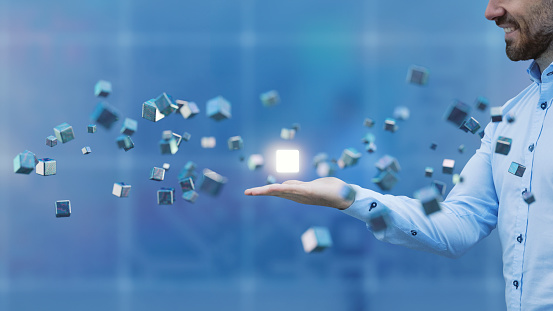 istock Businessman with flying cubes 670060572