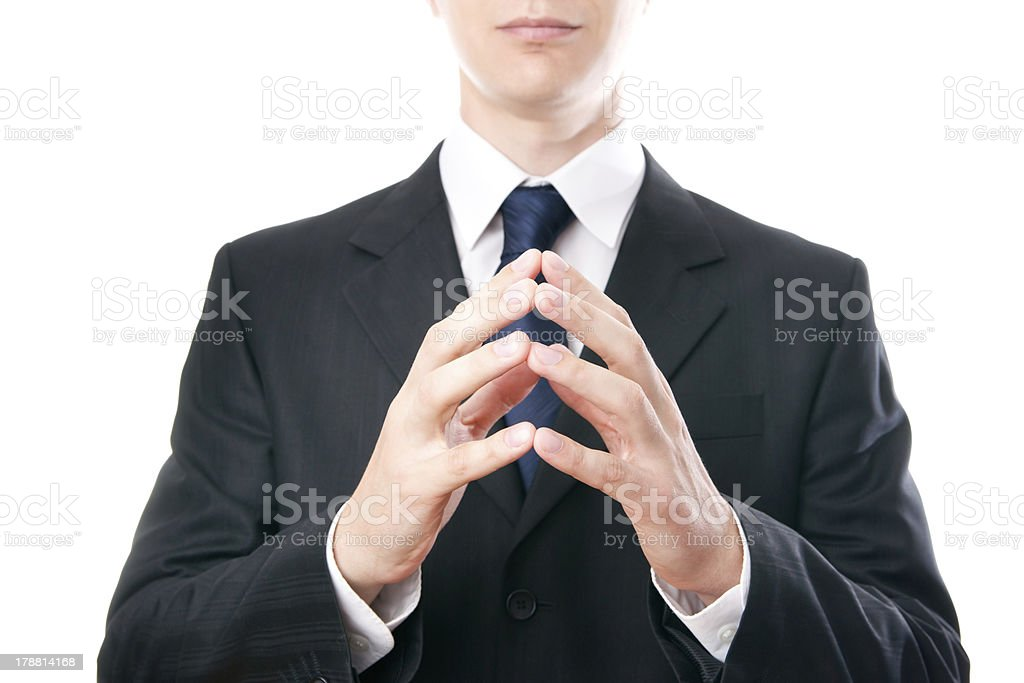 Businessman with folded hands stock photo