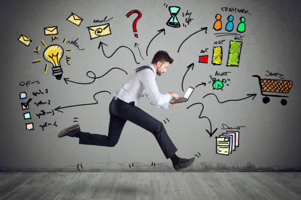 Businessman with four legs runs with too many tasks on laptop. Concept of stress and overwork stock photo