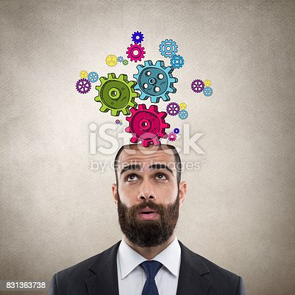 istock Businessman with gears 831363738