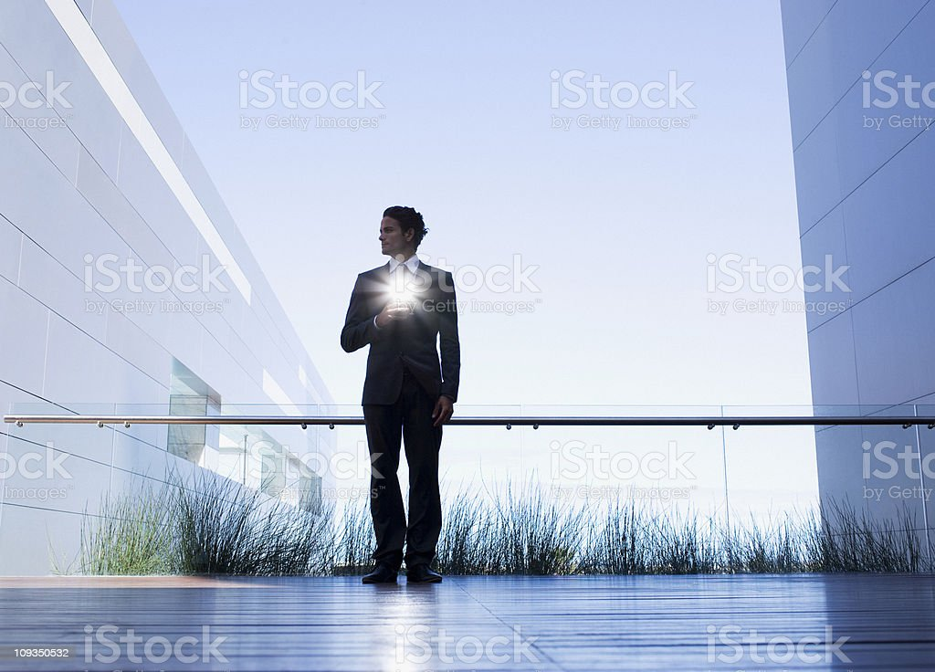 Businessman with glowing light on balcony royalty-free stock photo
