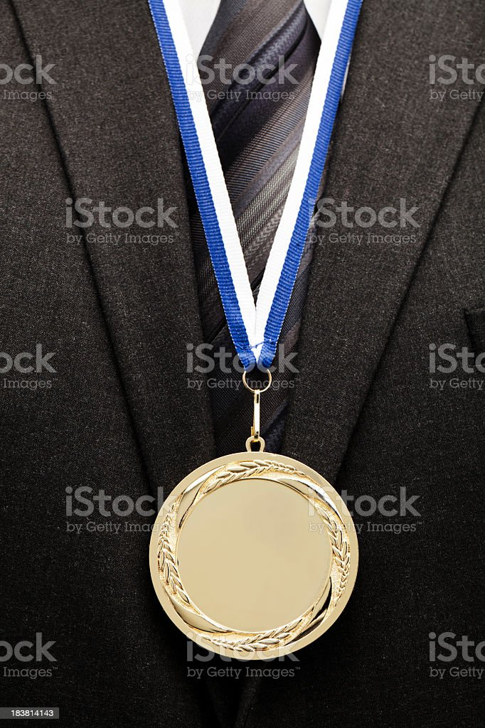 businessman with gold medal royalty-free stock photo