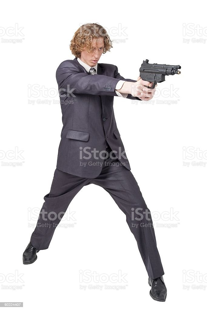 Businessman with gun royalty-free stock photo