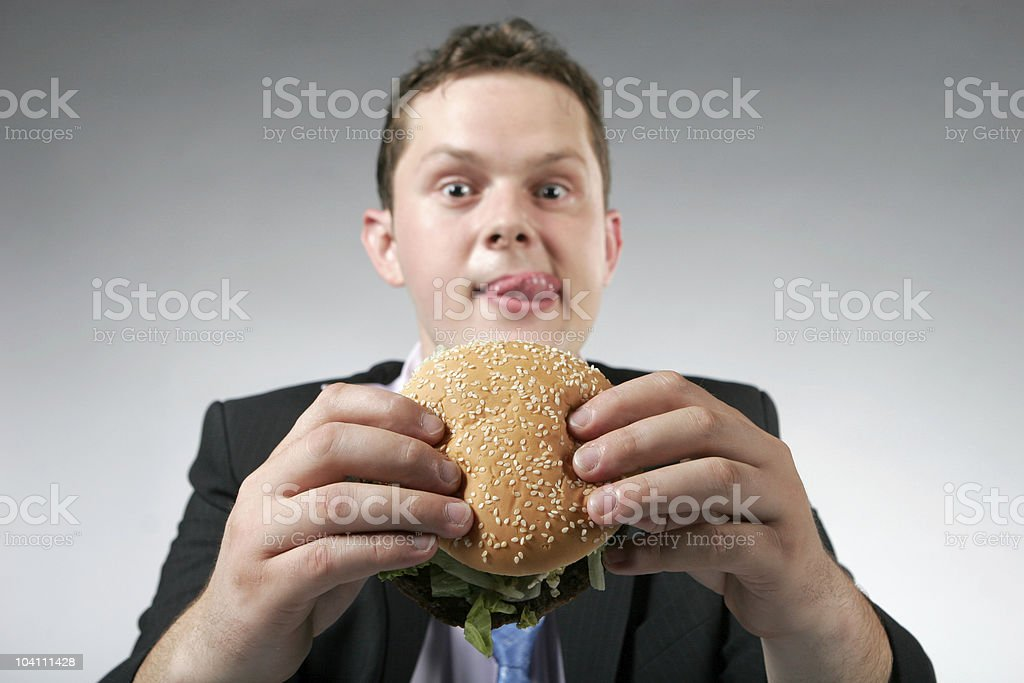 Businessman with hamburger royalty-free stock photo