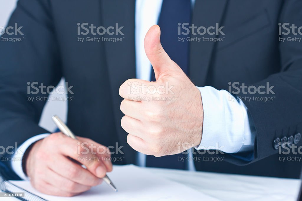 Businessman with hand in approval and okay stock photo