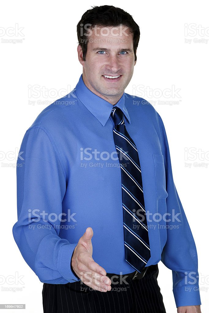 Businessman with hand out for handshake royalty-free stock photo
