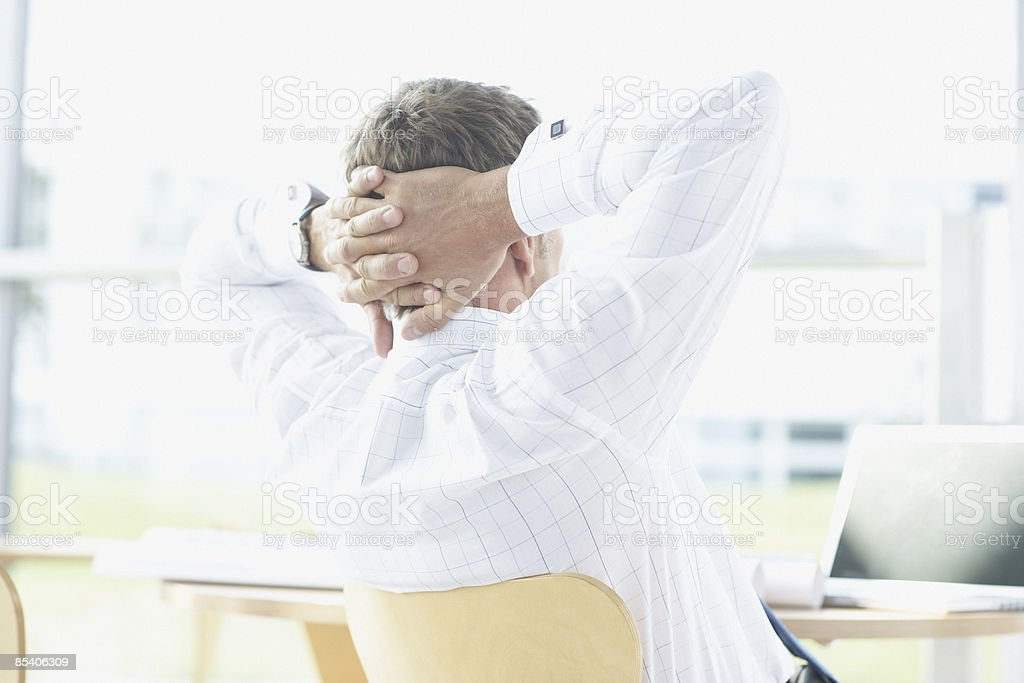 Businessman with hands behind head royalty-free stock photo