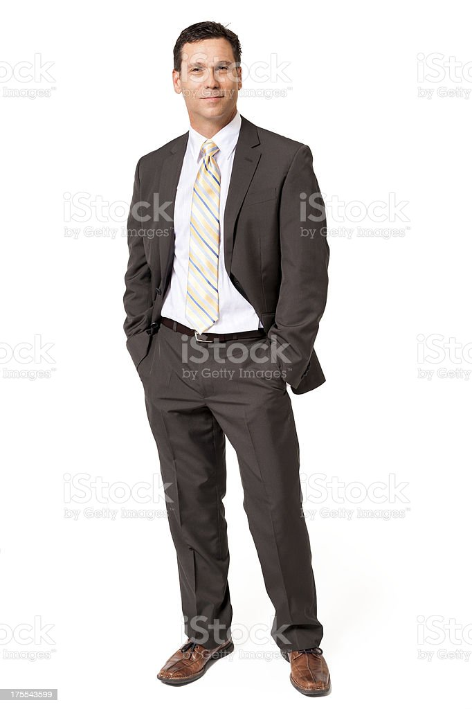 Businessman with Hands in Pockets Isolated on White Background stock photo