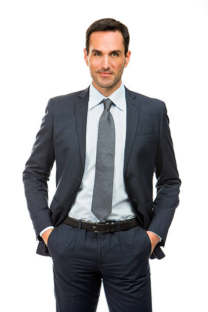 businessman with hands in pockets Half length portrait of a businessman with hands in his pockets hands in pockets stock pictures, royalty-free photos & images