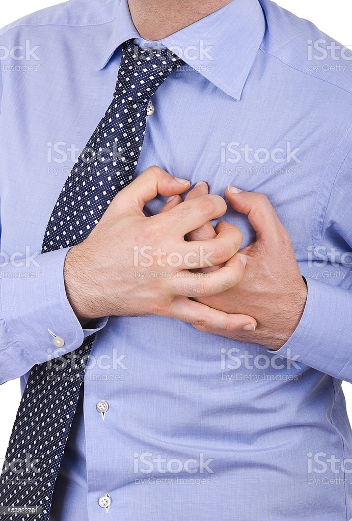 Businessman with heart attack. stock photo
