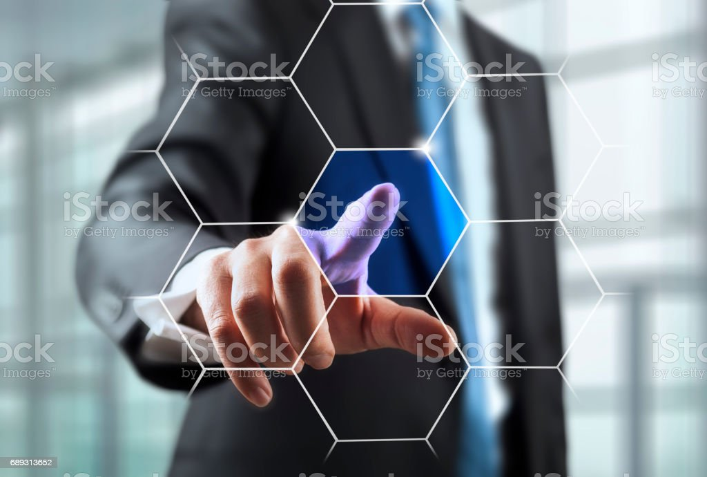 Businessman with hexagonal buttons for presentation stock photo