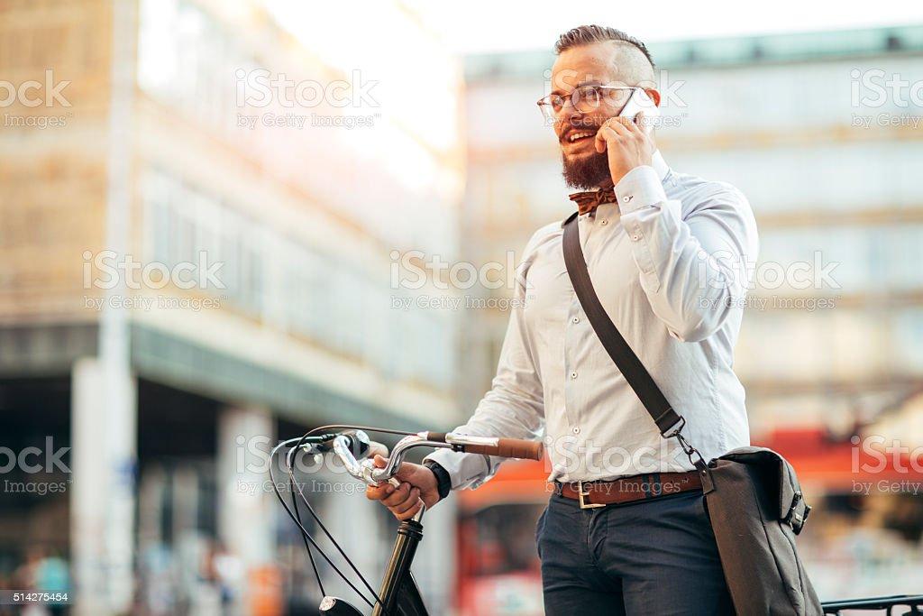 Empresário com seus Bycycle. - foto de acervo
