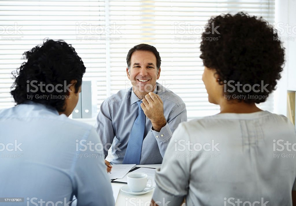 Businessman with his colleagues in a meeting royalty-free stock photo