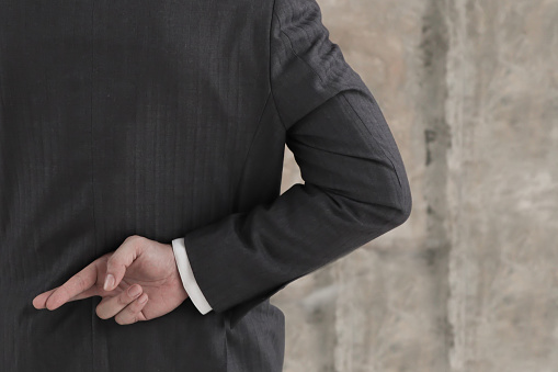 istock Businessman with his fingers crossed behind his back.Dishonest relationship and betrayal concept 1172304613